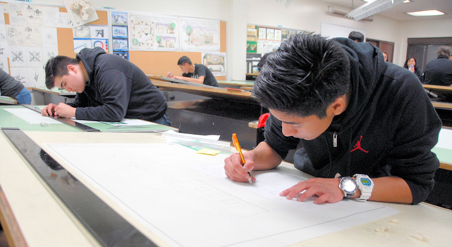 Students work in Architectural Drafting class