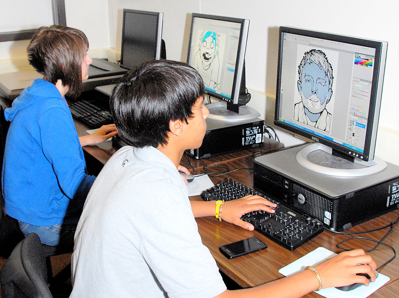 Graphic arts students work on computers