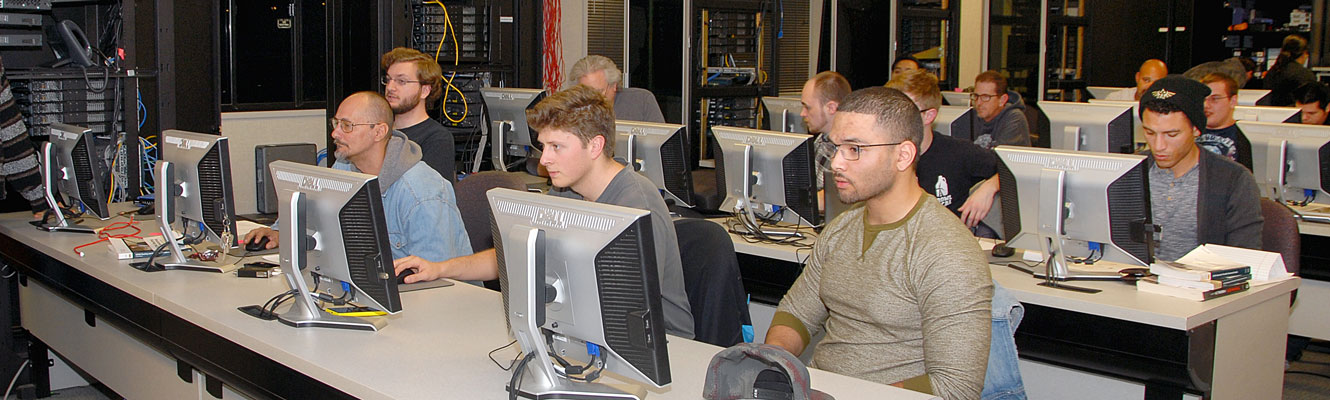 Cisco students work in their lab