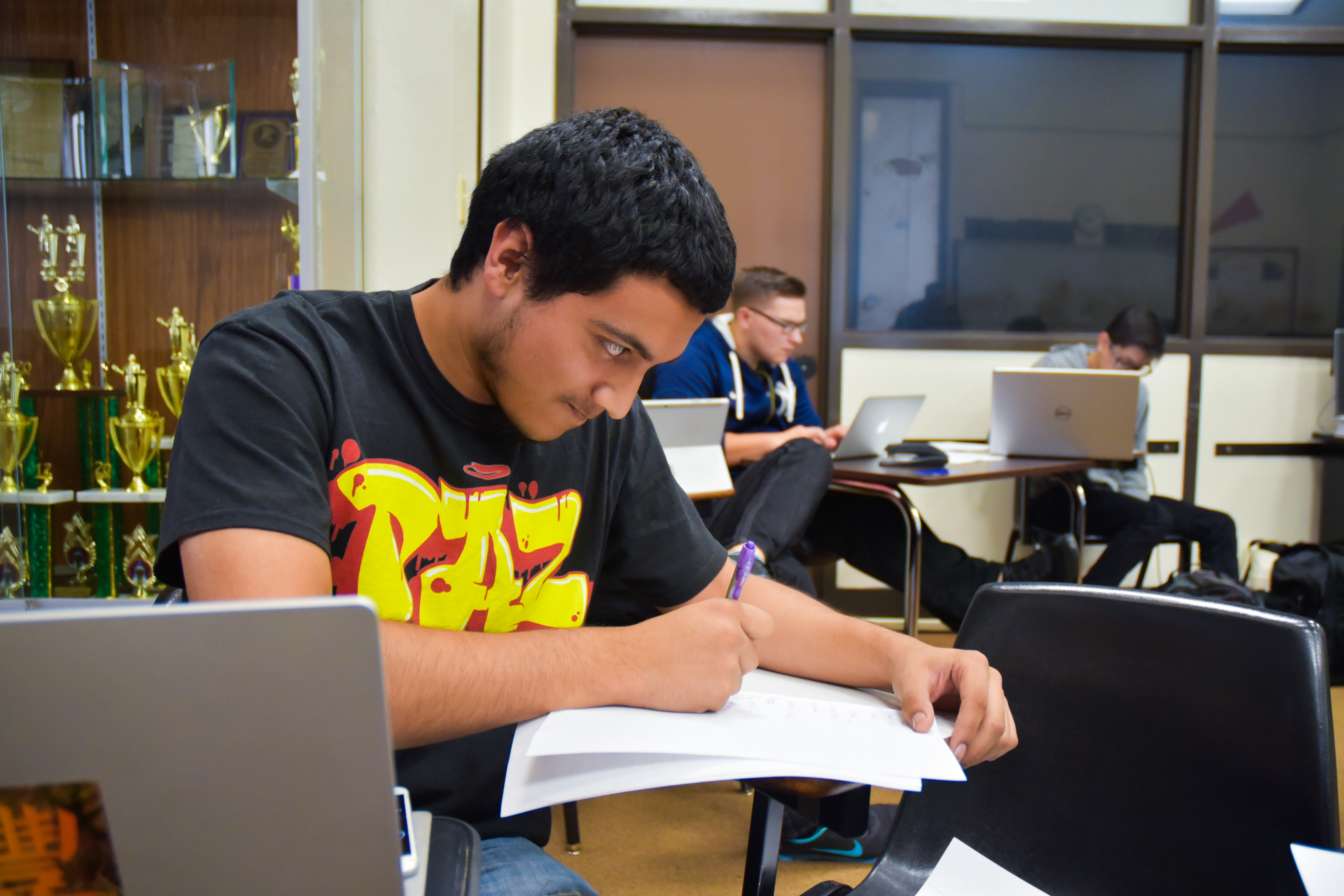 San Joaquin Delta College speech and debate team member Peter Perez jots down notes during his 20 minutes of prep time during a practice last week.
