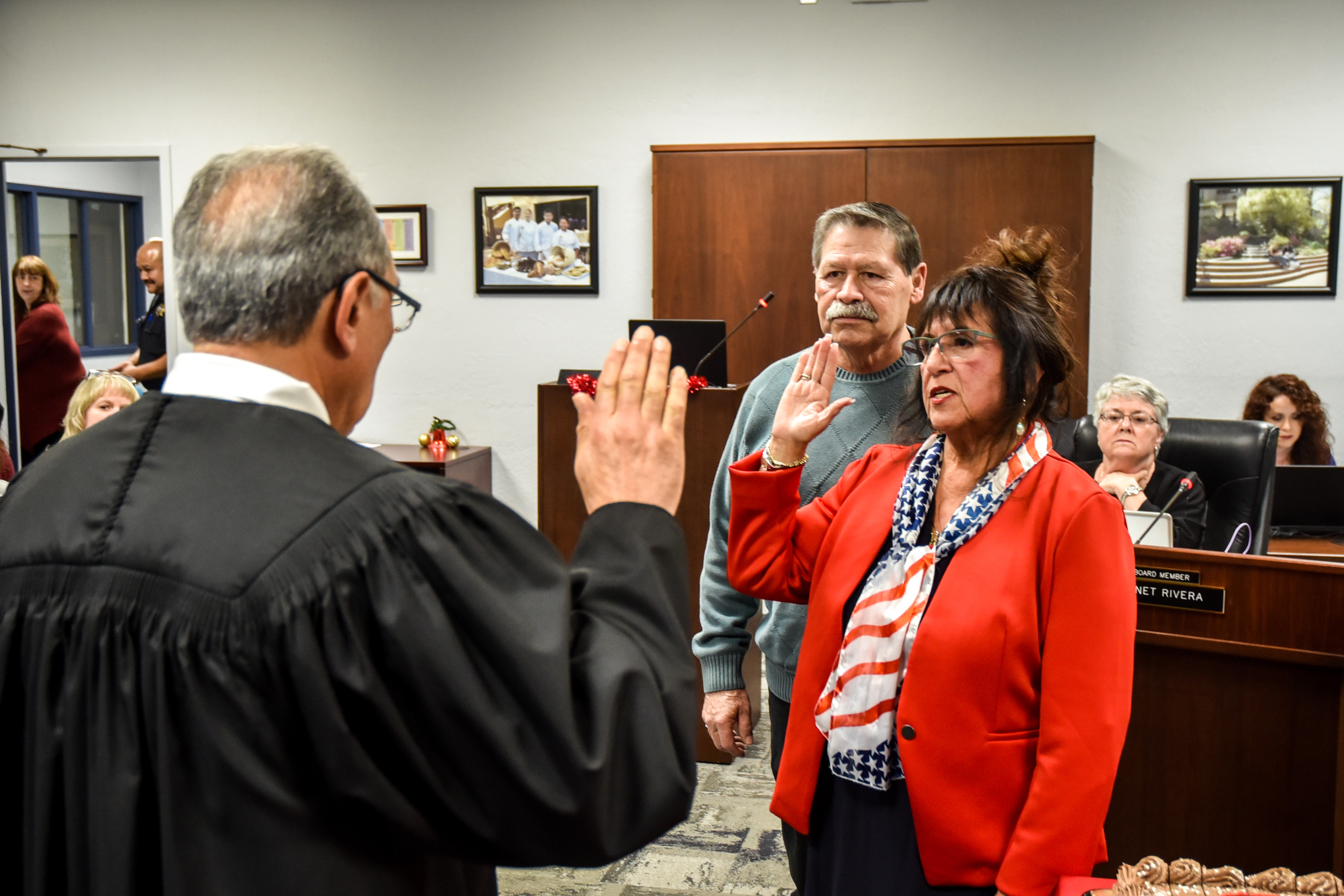 Returning San Joaquin Delta College Trustee Janet Rivera is sworn in while her husband, Rupert, watches.