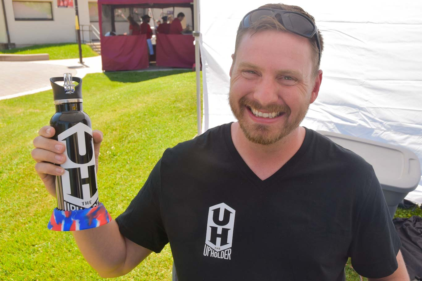 "Scott Yoder created ""The Upholder,"" a ring device that stabilizes bottles and cans so they don't spill. Yoder participated in the Student Entrepreneur Expo at San Joaquin Delta College."