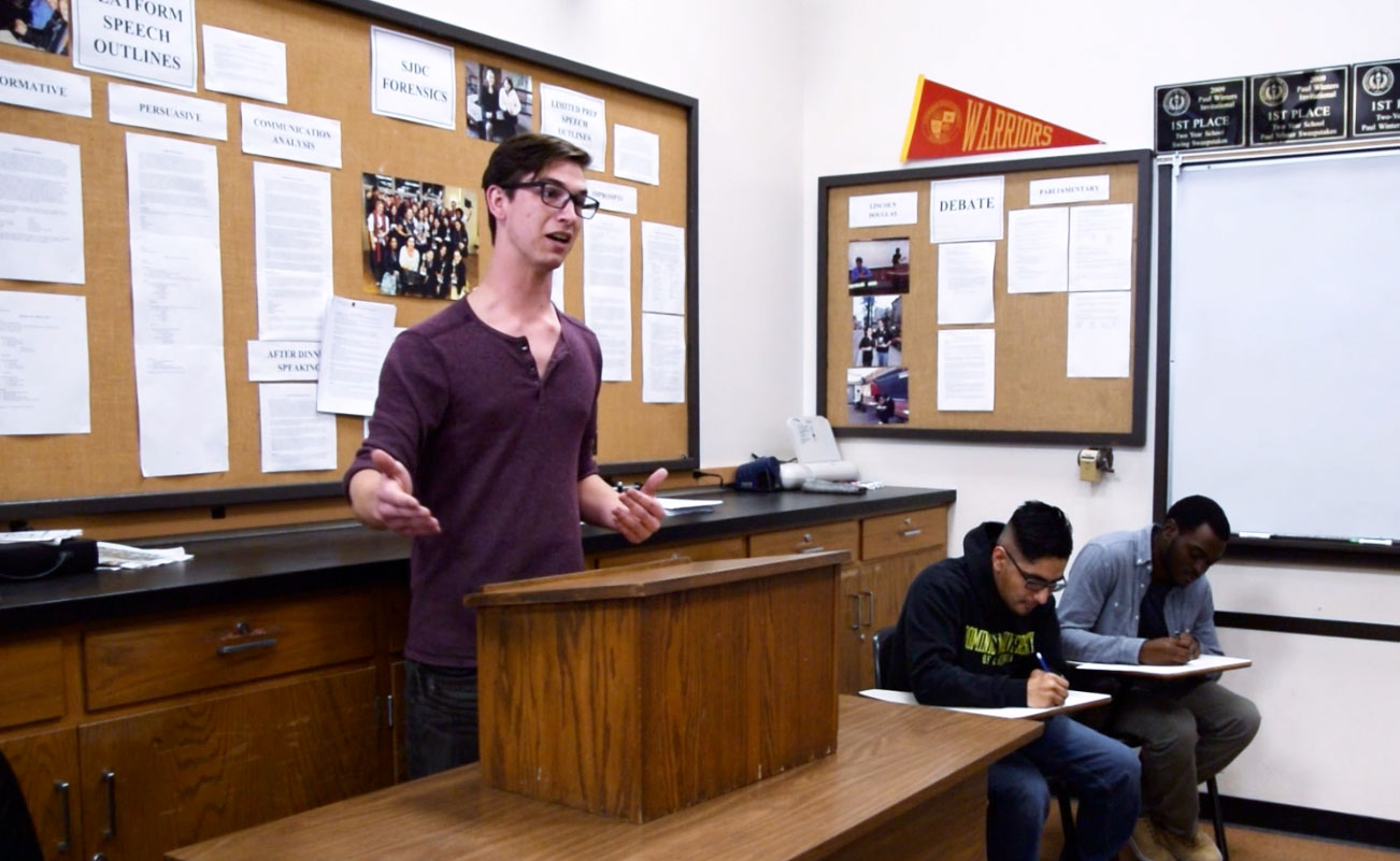 Student delivers speech during speech and debate practice