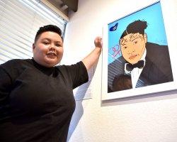 "San Joaquin Delta College student Celine Pham stands beside her piece, ""Be Yourself."""