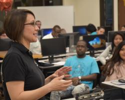 """Professor Alicia Stewart addresses students and community members during the recent """"GO LIVE with Top 25"""" event for job hunters"""