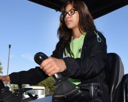 Young female student drives tractor