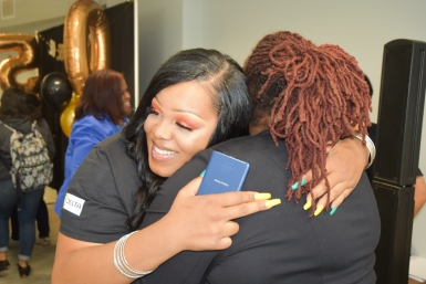 Se'Quoia Drew gets a hug from EOPS director Danita Scott at the 50th anniversary celebration for Delta's EOPS program.