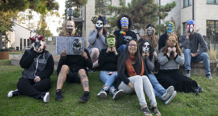 """""""Break the Silence,"""" a new art exhibition focused on mental health and wellbeing, opens on Jan. 24 at San Joaquin Delta College's Horton Art Gallery. The student artists pictured here created masks symbolizing resiliency. Photo by Dawn LeAnn"""
