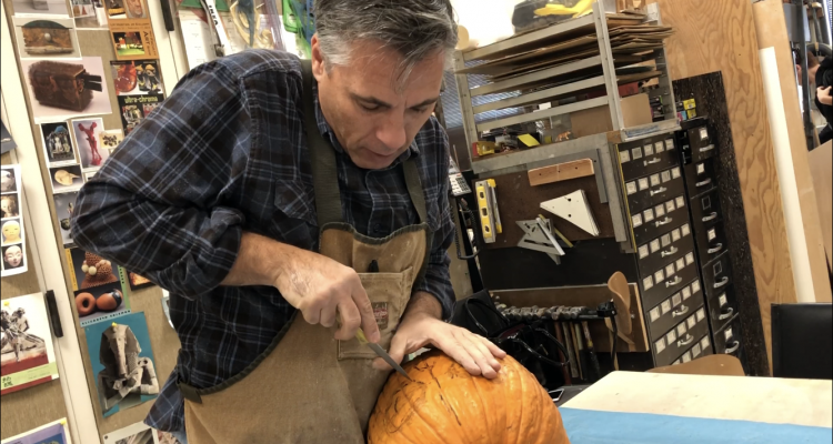 San Joaquin Delta College art professor Gary Carlos shows how to carve the perfect pumpkin. This pumpkin was auctioned off with the money going to student scholarships.