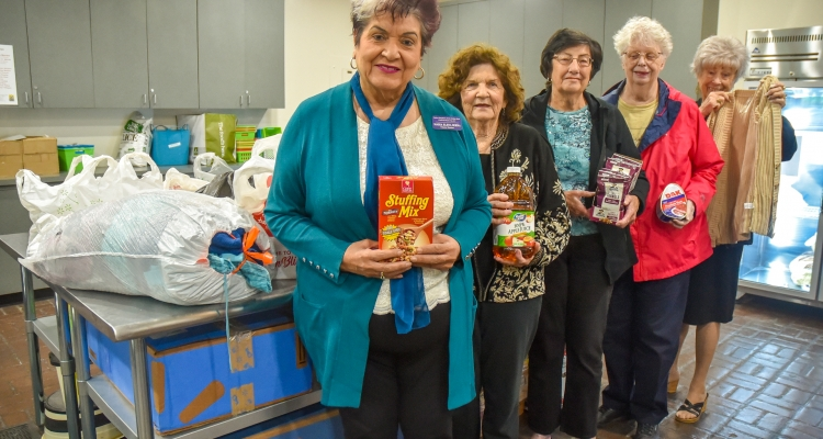 Members of the Native Daughters of the Golden West pose with donations they made to the Student Food Pantry at San Joaquin Delta College.