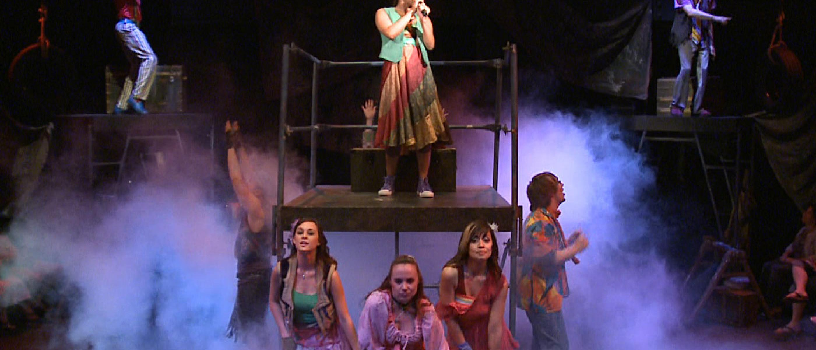 Students perform Godspell on stage