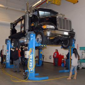 Students observe car in Diesel Tech class
