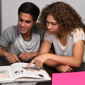 Students ready history book