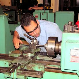 Student operates machinery in Mechanical Tech class