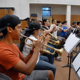 Students play trumpets in music class