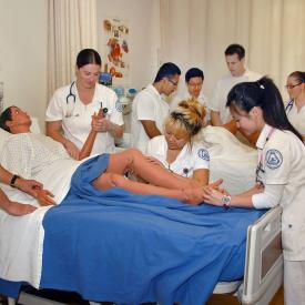 Nursing students care for dummy