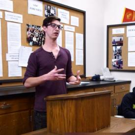 Student delivers speech in forensics class
