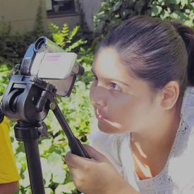Teenager takes video in Digital recording kids college program